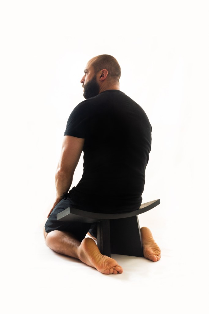 Camilo Andres sitting in a Coba Stool